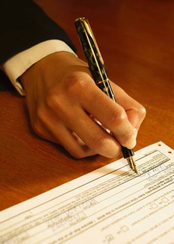 Business person signing a form